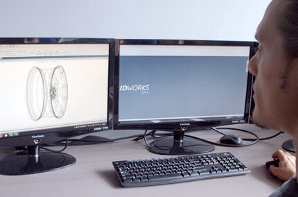 Transparent Vossen wheel being viewed by an employee on a computer